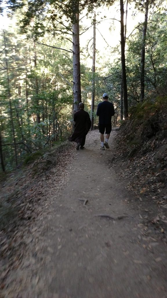 A monk and a man on the trail